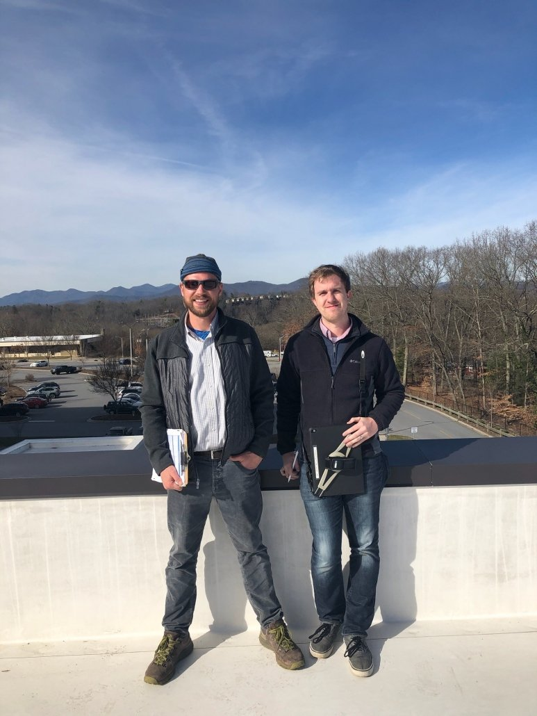 Evan Becka of Pisgah Energy and Jay Kiser of Optima Engineering on a rooftop in Asheville.