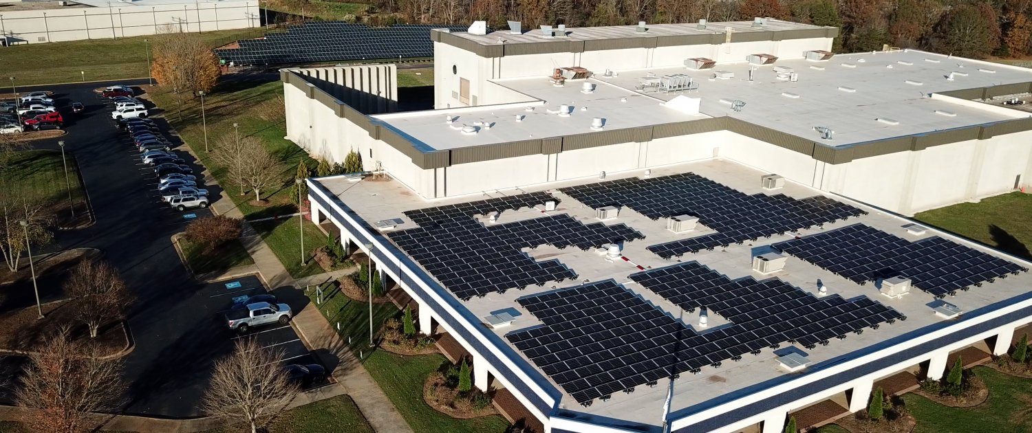 Picture of the roof and ground mount solar installation at Contec, Inc. Headquarters