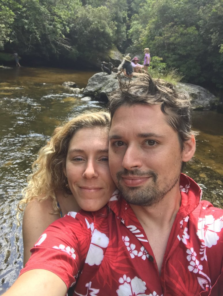 Image of Phelps Clarke and his wife, April standing by a river.